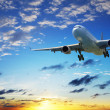 Jet plane in a sunset sky — Stock Photo