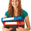 Cute young girl carying folders — Stock Photo