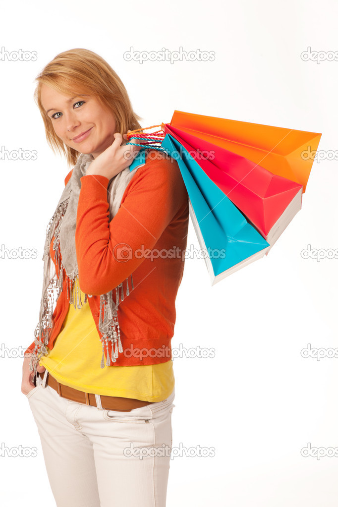 Cheerful young woman with shopping bags isoleted on  white background  Stock Photo #10235761