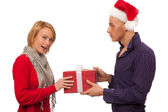Christmas gift - Man giving a present to a girl — Stock Photo