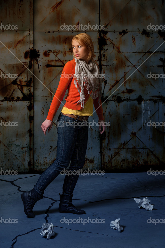 Frightened lone girl walking the street at night stock image