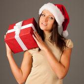 有吸引力的女孩圣诞老人帽子和上灰色金色 dressisolated — 图库照片