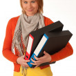 Attractive young girl carries file folders — Stock Photo #8326222