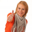 Young woman showing thumb up and smiles — Stock Photo #8326230