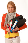 Attractive young girl carries file folders — Stock Photo