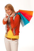 Cheerful young woman with shopping bags isoleted on white backg — Stock Photo