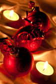 Red Baubles in candle light — Stock Photo