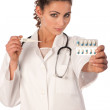 Young doctor with stethoscope , termomether and drugs — Stock Photo #8878430