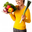 Attractive young woman with basket of vegetables — Stock Photo