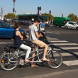Young couple on a tandem bike - Stock Photo