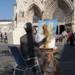 Street artist paints a picture of a Reims — Stock Photo