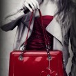 Fashion shot of red patent leather bag — Stock Photo