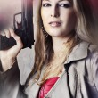 Fashion portrait of sexy woman with gun — Stock Photo