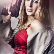 Fashion portrait of sexy woman with gun — Stock Photo #8683895
