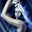 Young sexy woman warrior with sword - Stock Photo