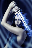 Young sexy woman warrior with sword — Stock Photo