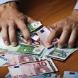 Male hands holding money — Stock Photo