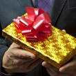 Male hands holding gift. — Stock Photo