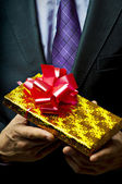 Male hand with gift. — Stock Photo