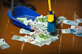Sweeping euro money banknotes — Stock Photo