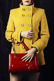 Red bag and fashion yellow coat — Stock Photo