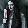 Portrait of a gory and scary zombie woman — Stock Photo