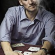Young man playing poker. Win — Foto de Stock