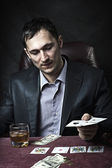 Business man winner playing poker — Stock Photo