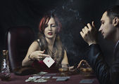 Couple playing poker — Stock Photo