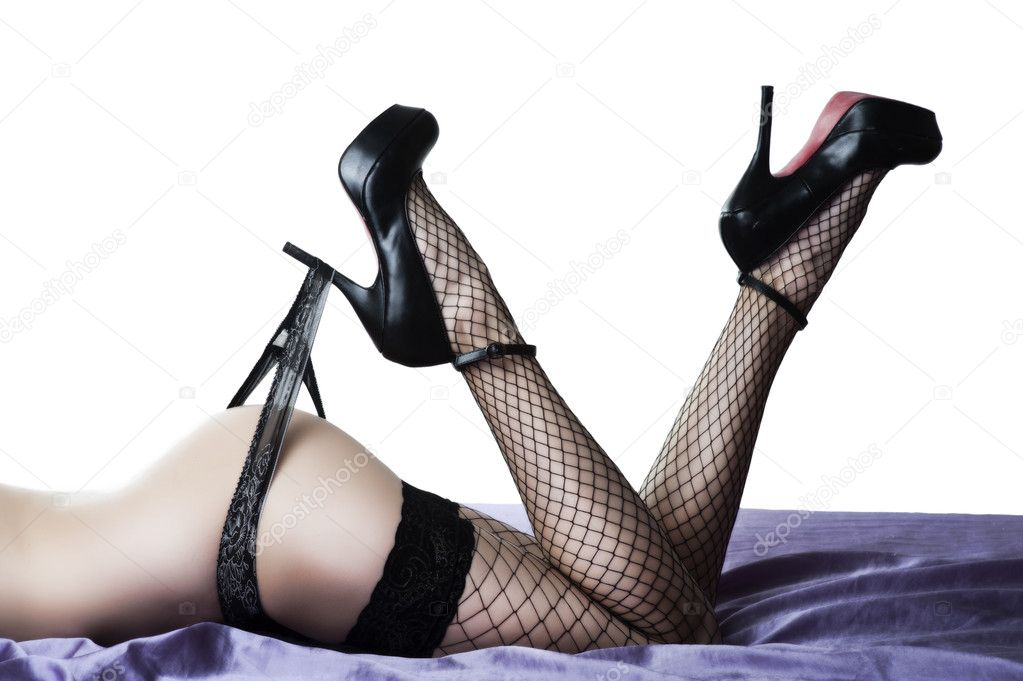 Sexy female buttocks and legs in high heel black shoes and stockings — Stock Photo #9580070