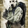 Doomsday. Man in gas mask with gun - Stock Photo