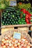 Fresh fruits and vegetables at the local market — Stock Photo