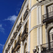 Mediterranean architecture in Spain. Old apartment building in Madrid. — Stock Photo #7970435