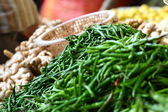 Green paprica in traditional vegetable market in India. — Stock Photo