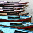 Colorful boats on brown waters of Ganges river, Varanasi, India — Foto Stock