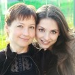 Portrait of happy beautiful mother and adult smiling daughter on — Stock Photo