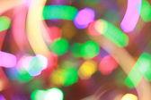 Luces de brillante colorido año nuevo. fondo de abstracción — Foto de Stock