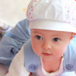 Closeup portrait of adorable baby girl in cap with blue eyes — Stock Photo
