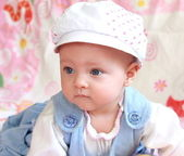 Portrait of beautiful baby girl in funny hat looking serious — Stock Photo