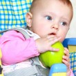 Stock Photo: Closeup portrait of surprised baby girl holding green apple and