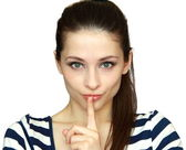 Closeup portrait of beautiful green eyes girl with silence sign — Stock Photo