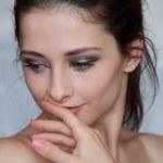 Closeup portrait of beautiful sexy young woman holding hand near — Stock Photo #9684545