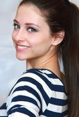 Closeup portrait of beautiful smiling friendly girl with long ha — Stock Photo
