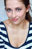 Closeup portrait of beautiful smiling girl face with green eyes — Stok fotoğraf
