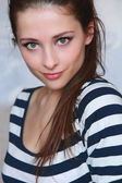Closeup fashion portrait of beautiful young woman face with gree — ストック写真