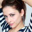 Closeup portrait of beautiful green eyes young woman in summer b - Stock Photo