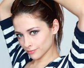 Closeup portrait of beautiful green eyes young woman in summer b — Stock Photo