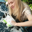 Young woman washing her car — Stock Photo