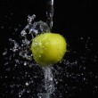 Fresh water splash and green apple isolated on — Stock Photo
