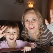 Mother and daughter talking in the Internet - Stock Photo